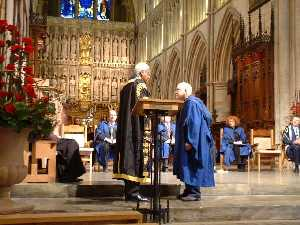 Chancellor Sir Trevor McDonald OBE conferring the Honorary Doctorate on Cliff